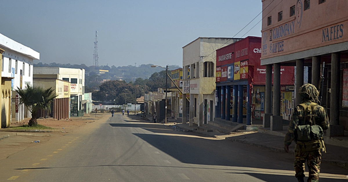 A Malawian soldier patrols the deserted streets of Lilongwe, on July 21, 2011, a day after mass protests against Malawi's President Bingu wa Mutharika. Eighteen people have died across Malawi after two days of violent protests that degenerated into looting and running battles with security forces, a health ministry spokesman said.</p>