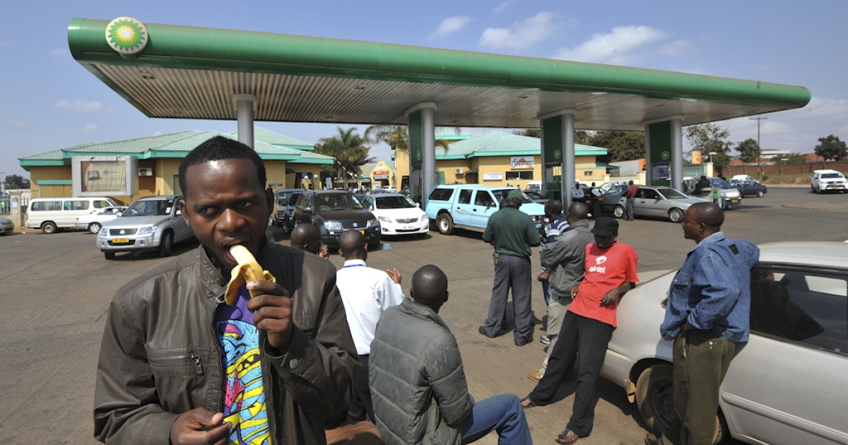 Malawians have lunch outside a petrol station where cars await fuel, in Lilongwe, on July 14, 2011. The United Kingdom has cut direct aid to Malawi as relations worsen following a diplomatic spat earlier this year in which each country expelled the other's envoy. Last year, the UK gave $30 million in budgetary support to Malawi. Fearing aid cuts, Malawi recently passed an austerity budget which did not include any foreign assistance. However, the UK is continuing to give Malawi other aid - which does not go through the government - worth about $145 million over the next year. The International Monetary Fund (IMF) has also cut aid to Malawi, which used to rely on donors for 40 percent of its budget.</p>