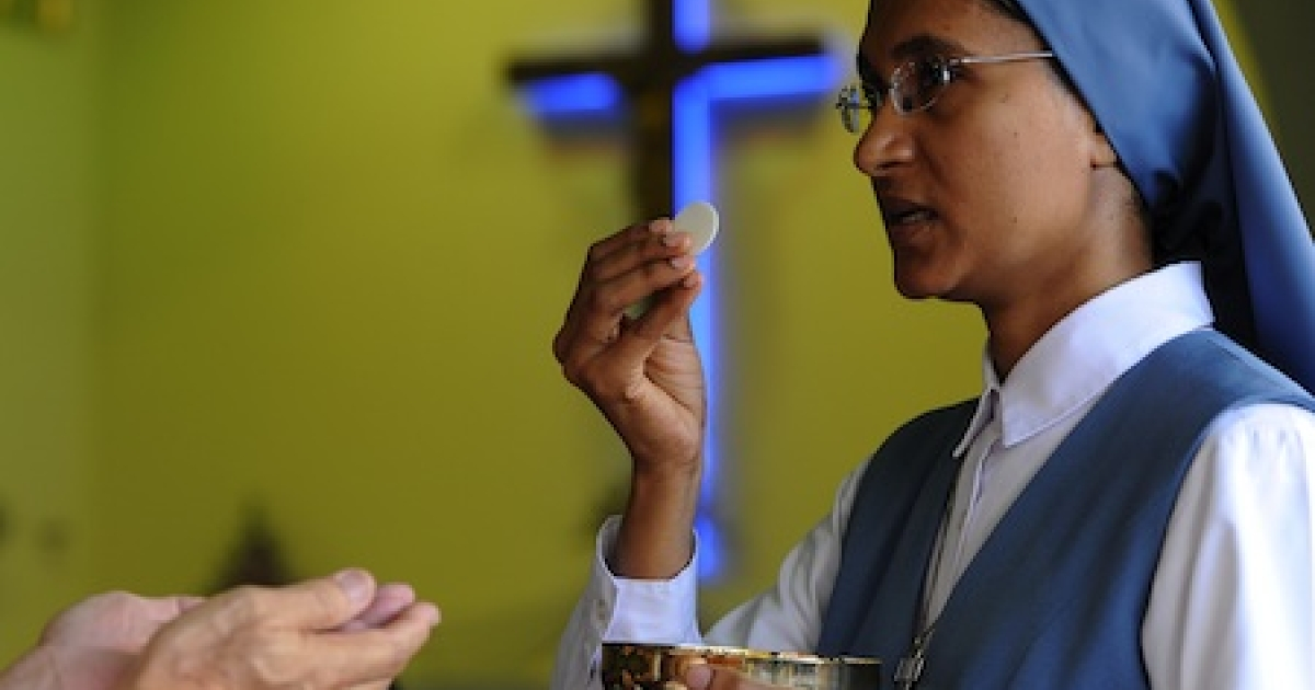 A Malaysian Christian participates in the communion rite at a Sunday service inside a church in Petaling Jaya near Kuala Lumpur on January 10, 2010. Malaysian Christians turned up to Sunday services in their thousands, presenting a united front of defiance in the face of a series of church firebombings that has heightened ethnic tensions. Four churches have been targeted since January 8 amid an escalating row over the use of the word 'Allah' as a translation for the Christian God by non-Muslims in the Muslim-majority nation.</p>