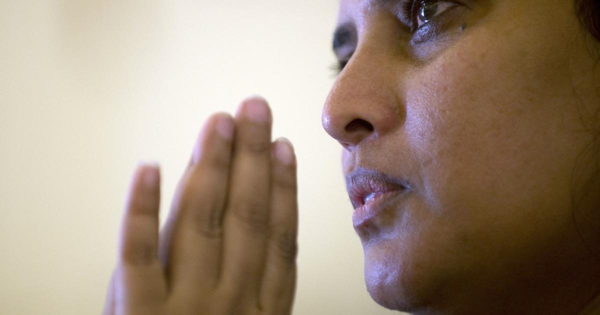 A Malay Christian prays on the outskirts of Kuala Lumpur on November 20, 2012.</p>