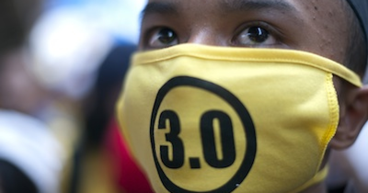 A protestor attends an anti-government rally while wearing Bersih 3.0 mask near the historical Merdeka Square in Kuala Lumpur on April 28, 2012. Thousands of protesters gathered in the Malaysian capital to demand electoral reforms, defying a lockdown of central Kuala Lumpur that left it a maze of razor wire and barricades.</p>