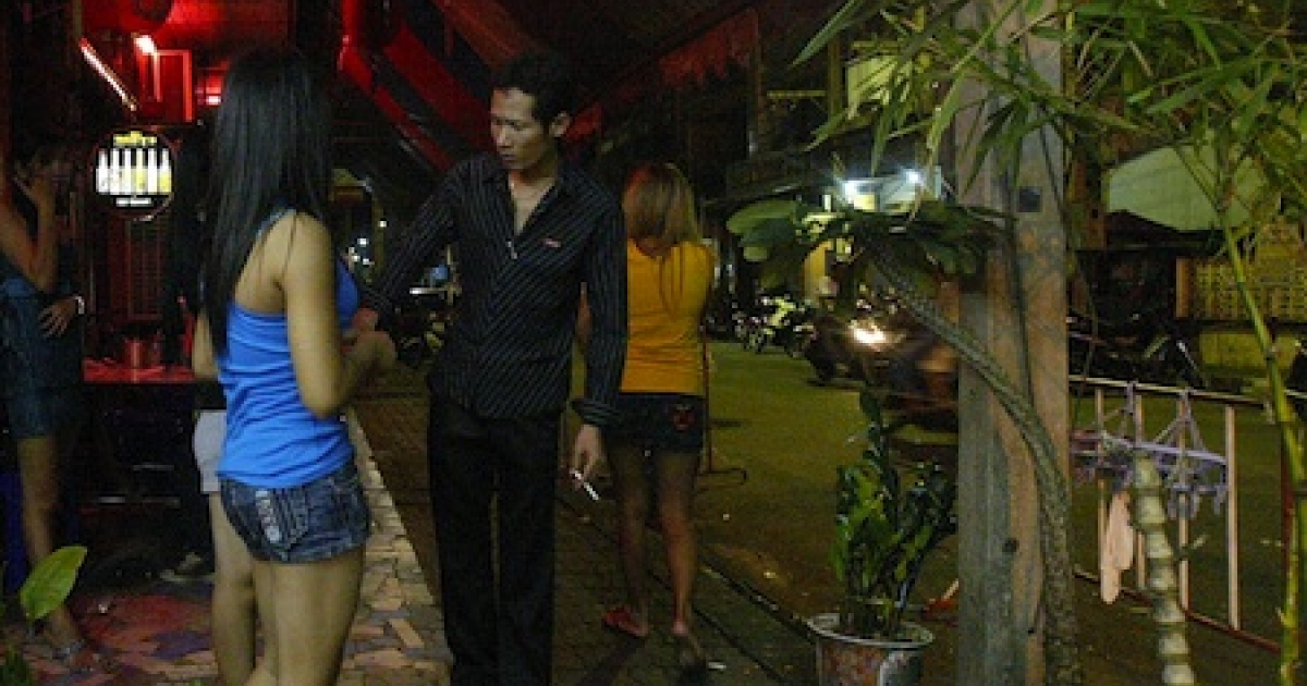 Sex workers and bar patrons in the Thai-Malay border town of Sungai Kolok.</p>