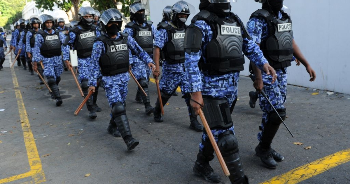 Maldivian policemen patrol the streets during clashes with anti-government protestors in the capital island Male on Feb. 8, 2012. The demonstrators were supporting former president Mohamed Nasheed who stepped down a day earlier.</p>