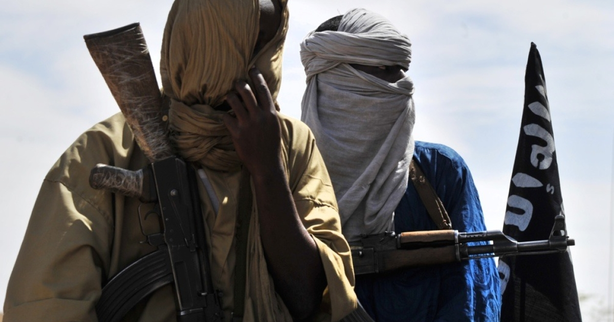 Two Al Qaeda-linked fighters patrol the streets of Gao, northern Mali, on July 16, 2012.</p>