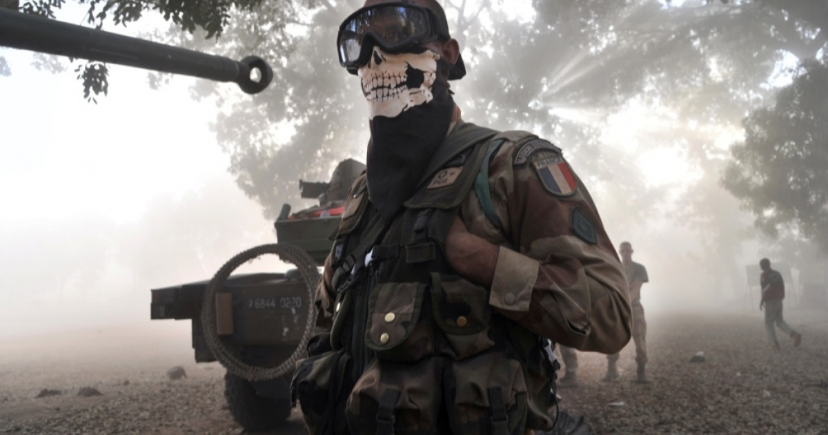 A French foreign legion soldier wearing a skeleton mask in Niono. Human rights activists allege Mali's army has killed dozens of people in reprisal attacks and ethnic murders.</p>