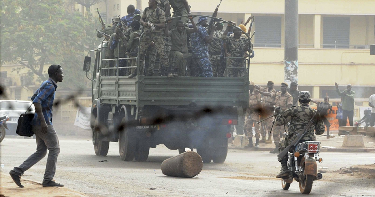 Soldiers crowd a truck in a street of Bamako on March 22, 2012. Malian President Amadou Toumani Toure, who was forced to flee his palace during an overnight coup, is well and in a safe location, a loyalist military source told AFP Thursday. Toure, who was to step down after an election scheduled for April 29, is