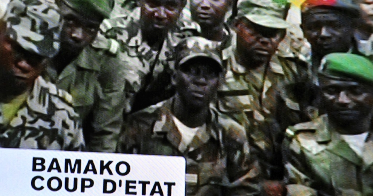 Photo of a TV screen taken on March 22, 2012, shows soldiers announcing a curfew in Bamako after their military coup. The putschists, calling themselves the National Committee for the Establishment of Democracy, said the government's 'inability' to put down a Tuareg-led insurrection in the north and tackle terrorism led to their rebellion.</p>