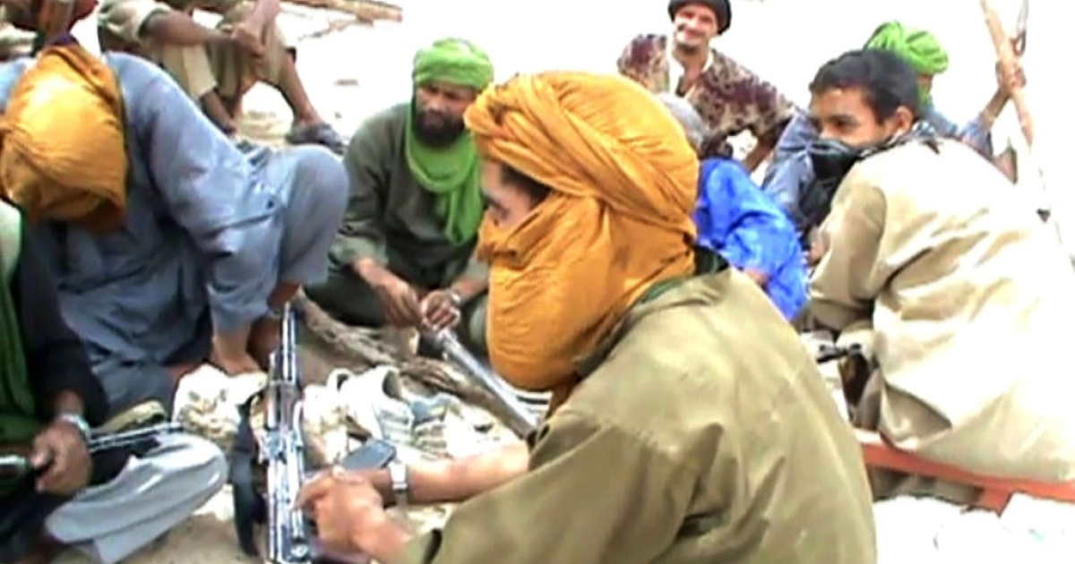A still from a video shows Islamist militants sitting on the ground with their weapons after destroying an ancient shrine in Timbuktu on July 1, 2012. Islamist rebels in northern Mali smashed four more tombs of ancient Muslim saints in Timbuktu on July 1.</p>
