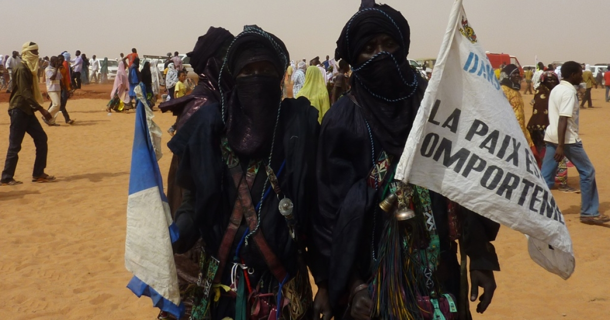 Ex-members of the Tuareg rebellion hold a sign which reads 'Peace is an attitude', at the 'Forum for Peace and Development', on January 22, 2012, in Arlit, a city know for its uranium mining. Addressing the Forum, Niger's President Mahamadou Issoufou warned of a new Tuareg rebellion in the north of the country after clashes between soldiers and rebels in neighboring Mali.</p>