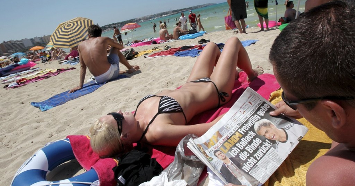 Germany may have a great economy but Spain has great beaches as this German tourist in Mallorca would probably be willing to admit.</p>