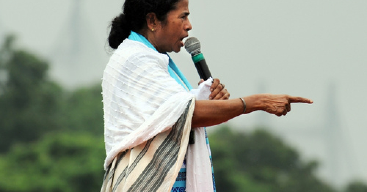 Bad PM, bad! Trinamool Congress leader Mamata Banerjee (shown here at a 2011 campaign rally) scolded Prime Minister Manmohan Singh for his move to hike India's petrol prices on Thursday. Economists argue the move was needed to stop the plunging rupee and get India's economy back on track. But if Banerjee withdraws support for Singh's United Progressive Alliance, India may be headed for early polls.</p>