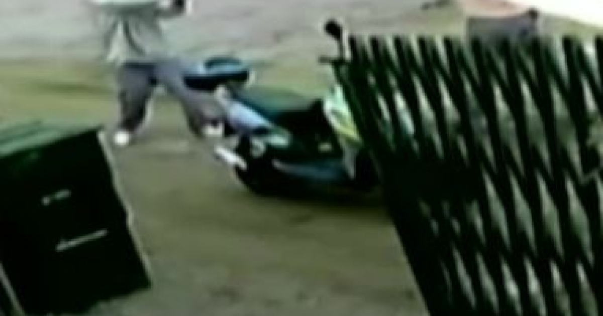 An armed teenager is shown pointing a gun at a 56-year-old Indiana man who fought with the teen to keep his friend's moped from being stolen.</p>