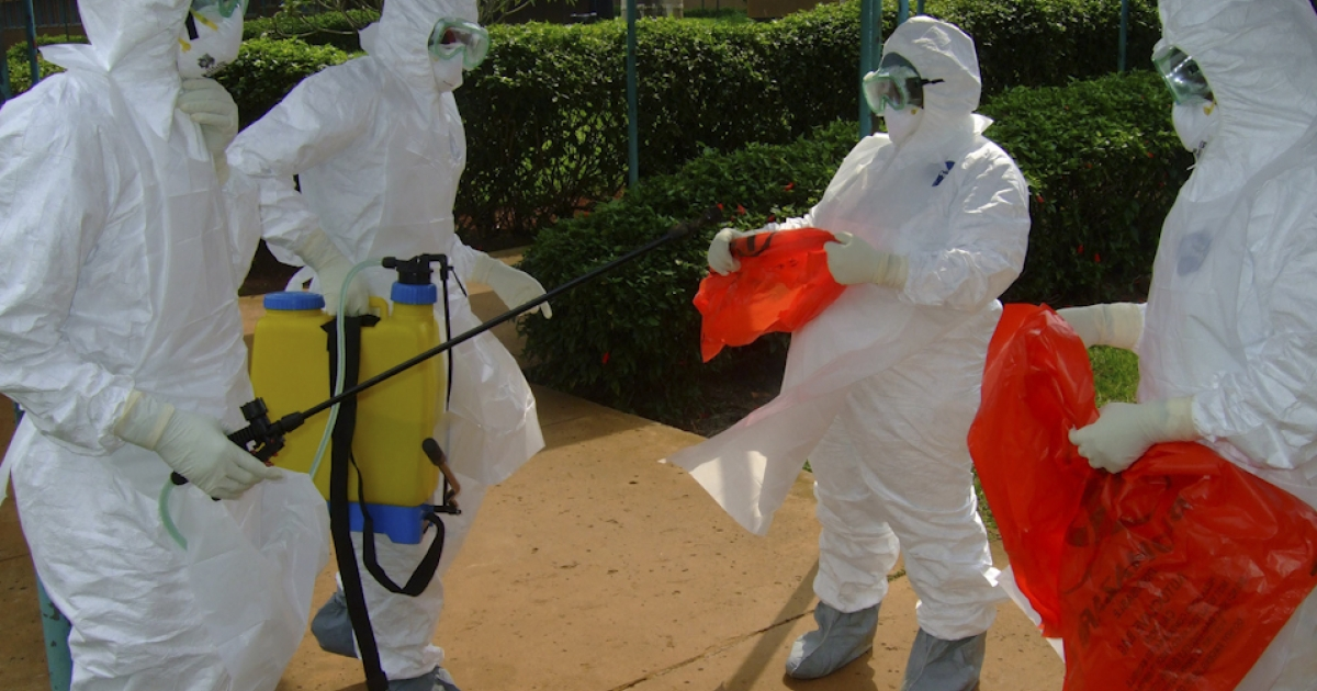 Officials from the World Health Organization wear protective clothing on July 28, 2012 as they prepare to enter Kagadi Hospital in Kibale District, about 200 kilometres from Kampala, Uganda, where an outbreak of Ebola virus started. The World Health Organization has said there is no need to panic and that everything has been done to contain the situation. In a statement yesterday,Ugandan President Museveni urged the public to desist from physical contact, such as shaking hands, in order to prevent a further spread of the disease.</p>