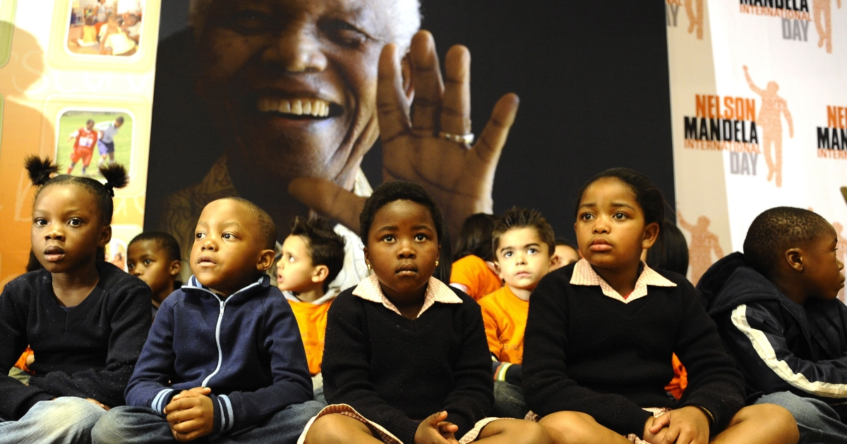 A group of schoolchildren participate in a symbolic handover on July 17, 2011 at the Nelson Mandela Foundation in Johannesburg to set the tone before the Mandela's 93rd birthday and Mandela Day on July 18, 2011.</p>