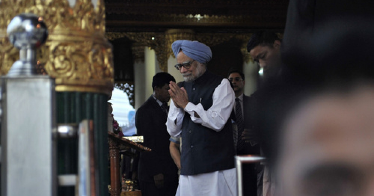 India's Prime Minister Manmohan Singh prays during his visit at Shwedagon pagoda in Yangon on May 29, 2012. Singh returned home to new allegations of corruption from social activist Anna Hazare.</p>