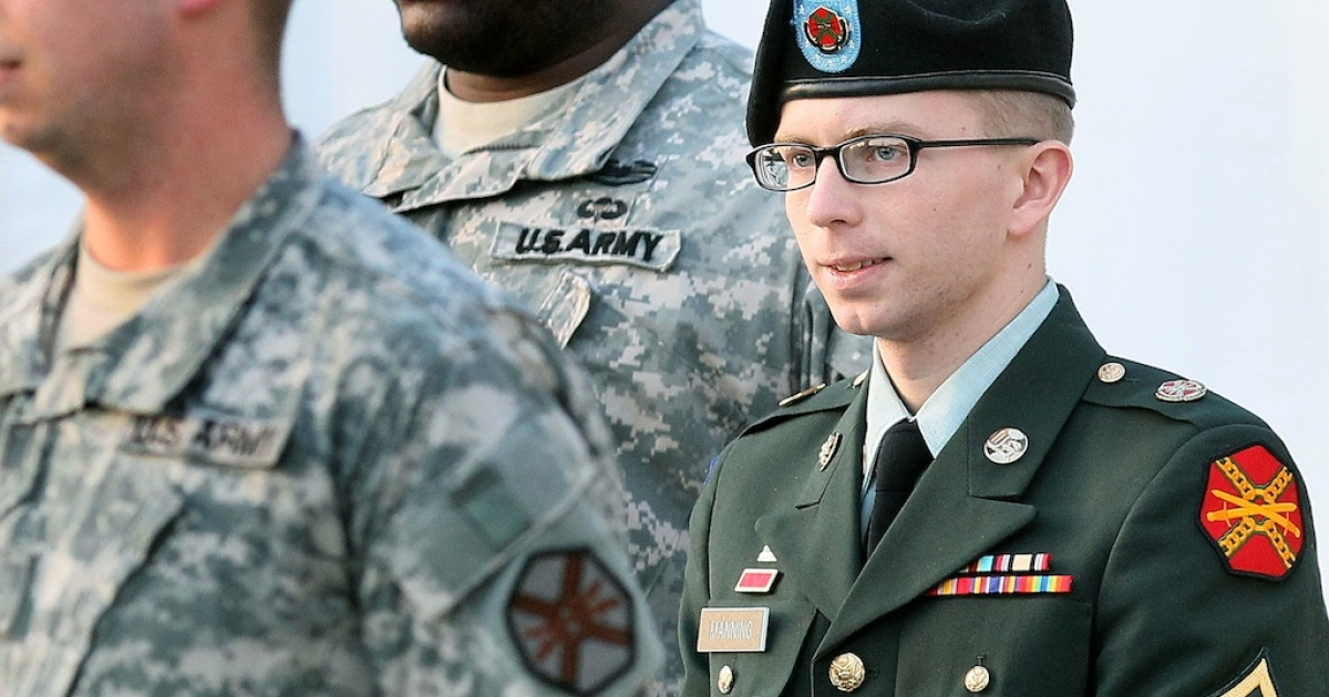 FORT MEADE, MD - FEBRUARY 23: Army Private Bradley Manning is escorted away from his Article 32 hearing February 23, 2012 in Fort Meade, Maryland. During the hearing, Manning deferred his plea to the 22 charges against him and deferred a decision over whether he wanted a military judge or a jury to hear his case.</p>