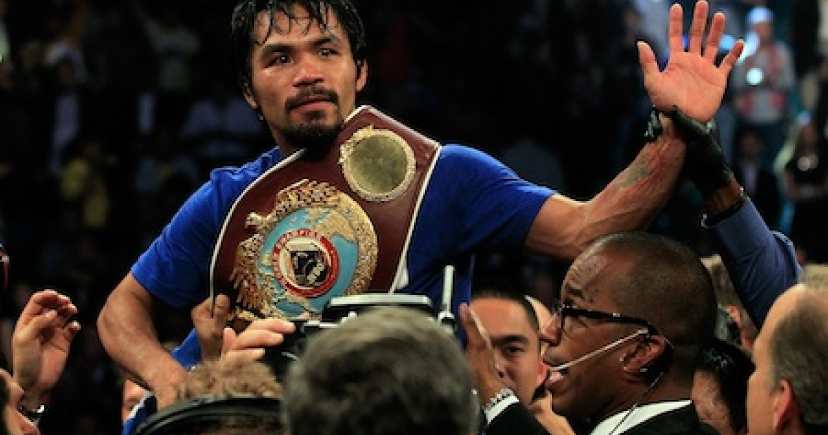 Manny Pacquiao of the Philippines celebrates after his unanimous decision victory against Shane Mosley in the WBO welterweight title fight at MGM Grand Garden Arena on May 7, 2011 in Las Vegas, Nevada.</p>