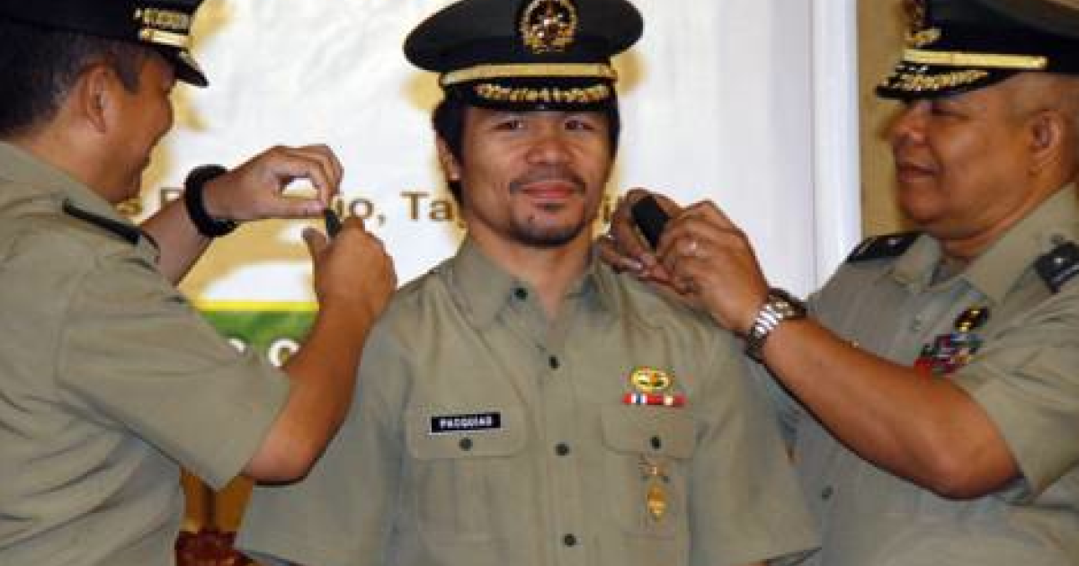 Boxer and Congressman Manny Pacquiao is promoted to lieutenant colonel in the Philippine Army.</p>