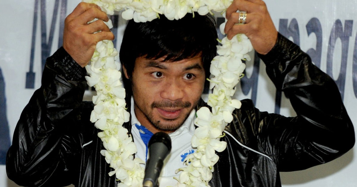 Philippine boxing icon Manny Pacquiao prepares to speak to supporters at Manila's international airport on December 12, 2012, upon his return from the United States and a loss to Mexican Juan Manuel Marquez.</p>