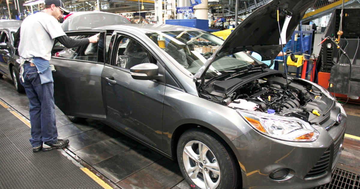 A Ford worker assembles a 2013 Ford Focus gasoline-powered, vehicle at the Michigan Assembly Plant November 8, 2012 in Wayne, Michigan.</p>