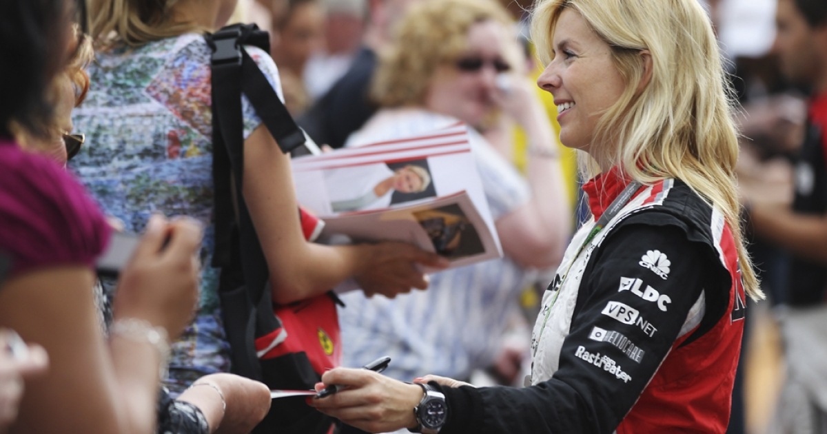 Maria de Villota of Spain signs autographs during previews to the Monaco Formula One Grand Prix in Monte Carlo on May 25, 2012.</p>