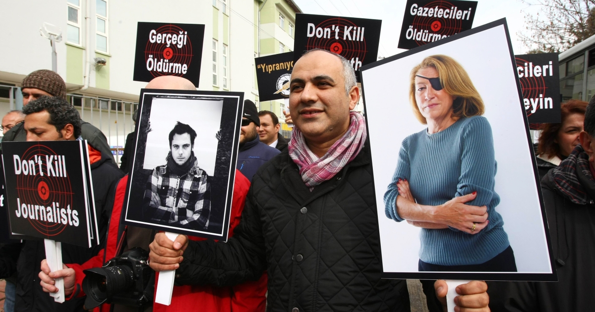 A Turkish demonstrator in Ankara holds pictures last week of the late Sunday Times correspondent Marie Colvin and French photojournalist Remi Ochlik, left, during protest by journalists against violence on the news media in Syria.</p>