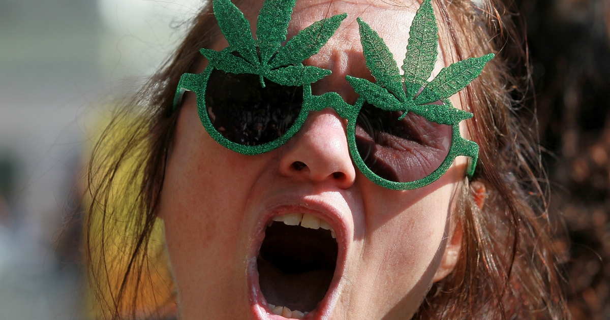 A medical marijuana advocate demonstrates outside the W Hotel in San Francisco, Calif., on Oct. 25, 2011.</p>