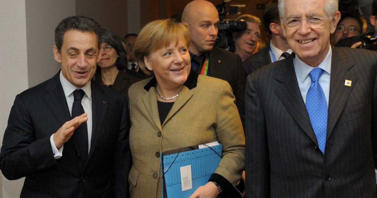 (L-R) France's President Nicolas Sarkozy, Germany's Chancellor Angela Merkel and Italy's Prime Minister Mario Monti speak together prior to a meeting at the European Council in Brussels ahead of the European Union leaders summit on Jan. 30, 2012.</p>