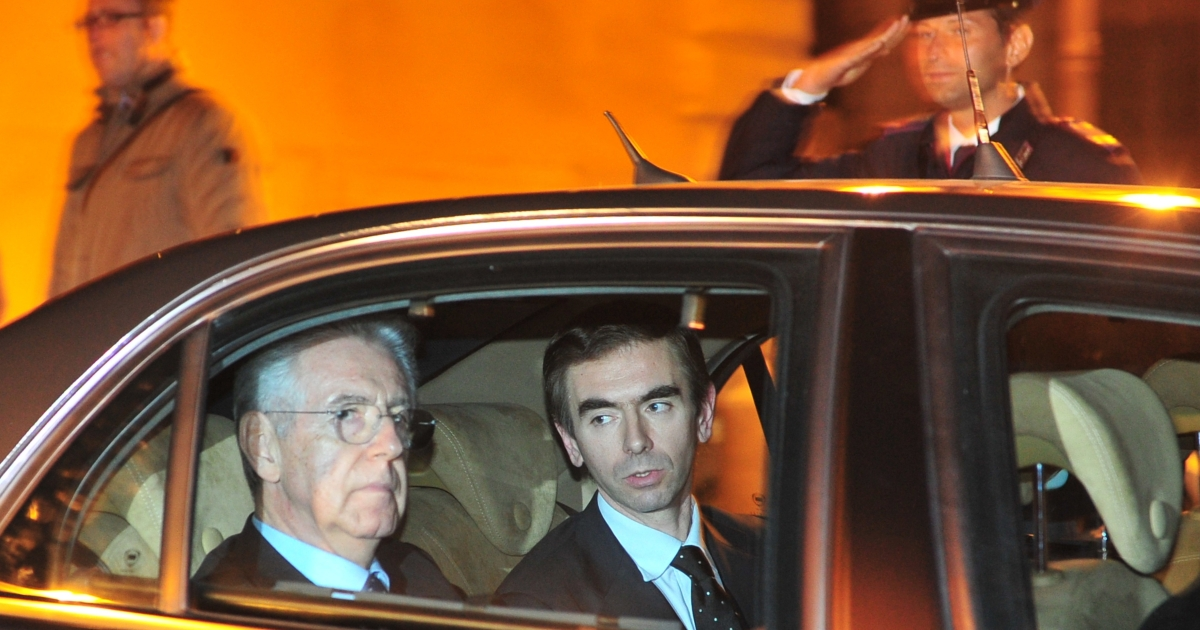 Newly-named Italian Prime Minister Mario Monti (L) leaves the presidential palace on Nov. 13, 2011, after Italian President Giorgio Napolitano nominated him to form a new government.</p>