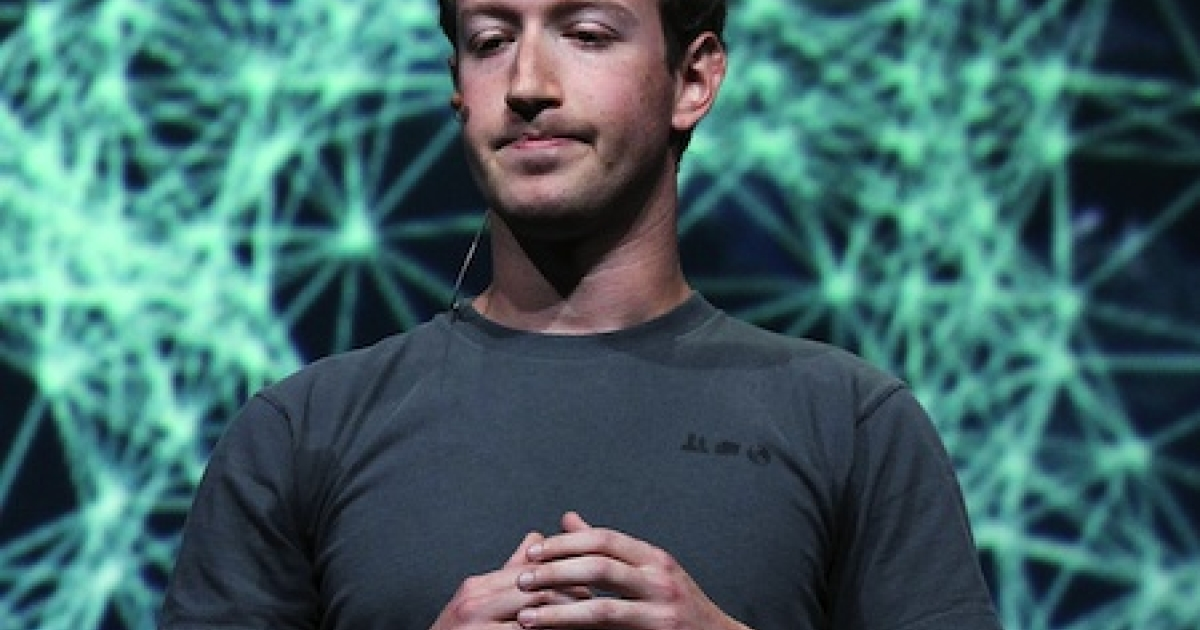 Facebook CEO Mark Zuckerberg pauses as he delivers a keynote address during a Facebook f8 conference on September 22, 2011 in San Francisco, California.</p>