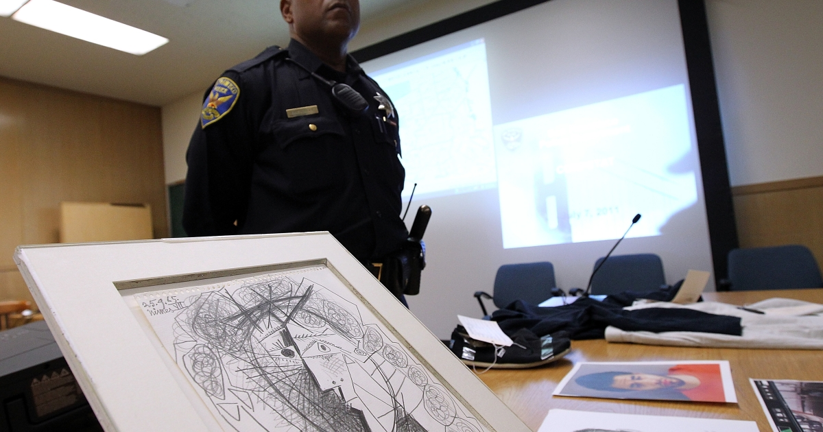 A policeman stands on July 7 by a Picasso drawing recovered less than 48 hours after it was stolen from the Weinstein Gallery in San Francisco, California.</p>