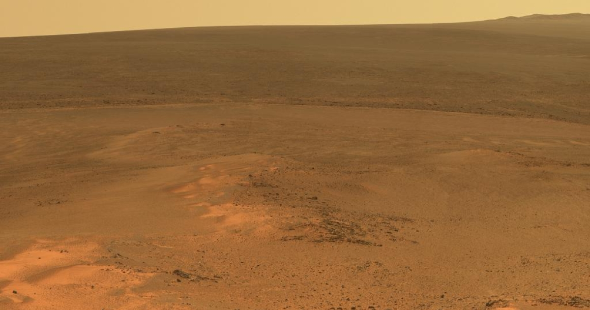 This mosaic of images taken in mid-January 2012 shows the windswept vista northward (left) to northeastward (right) from the location where NASA's Mars Exploration Rover Opportunity is spending its fifth Martian winter, an outcrop informally named