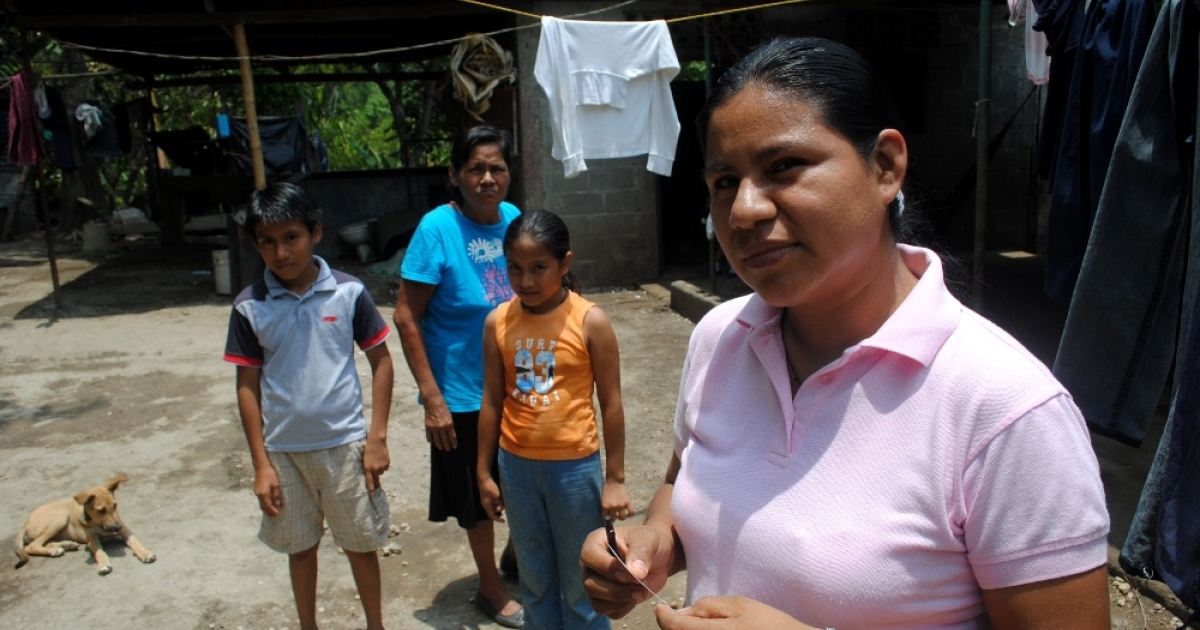 Martha Acuña at home in Masaya, Nicaragua with her mother and two children. Her husband's death in a motorcycle accident left her as the only wage-earner in the eight-member household.</p>