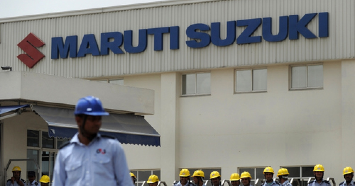Indian private security guards stand in front of the main gate of the Maruti Suzuki Production Facility in Manesar, about 45 kms from New Delhi on June 16, 2011.</p>
