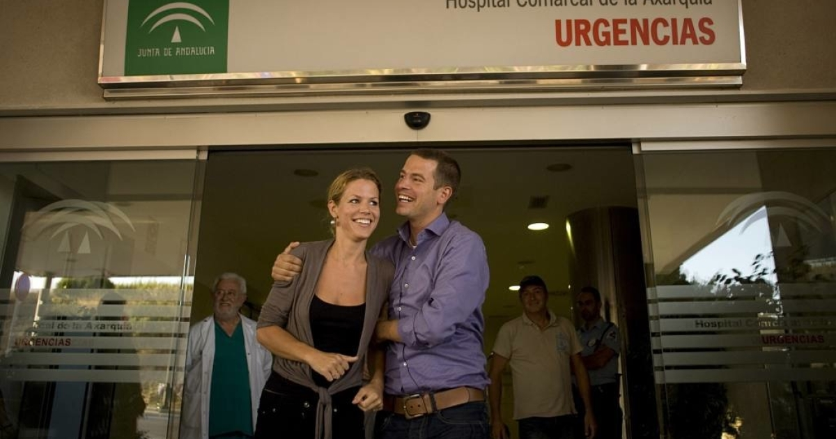 Jantje and Fritz, daugther and son of Mary-Anne Goossens, who spent 18 days trapped at the bottom of a Spanish ravine, smile at the entrance of the hospital in Velez-Malaga on July 6, 2011, where their mother is staying for observation.</p>