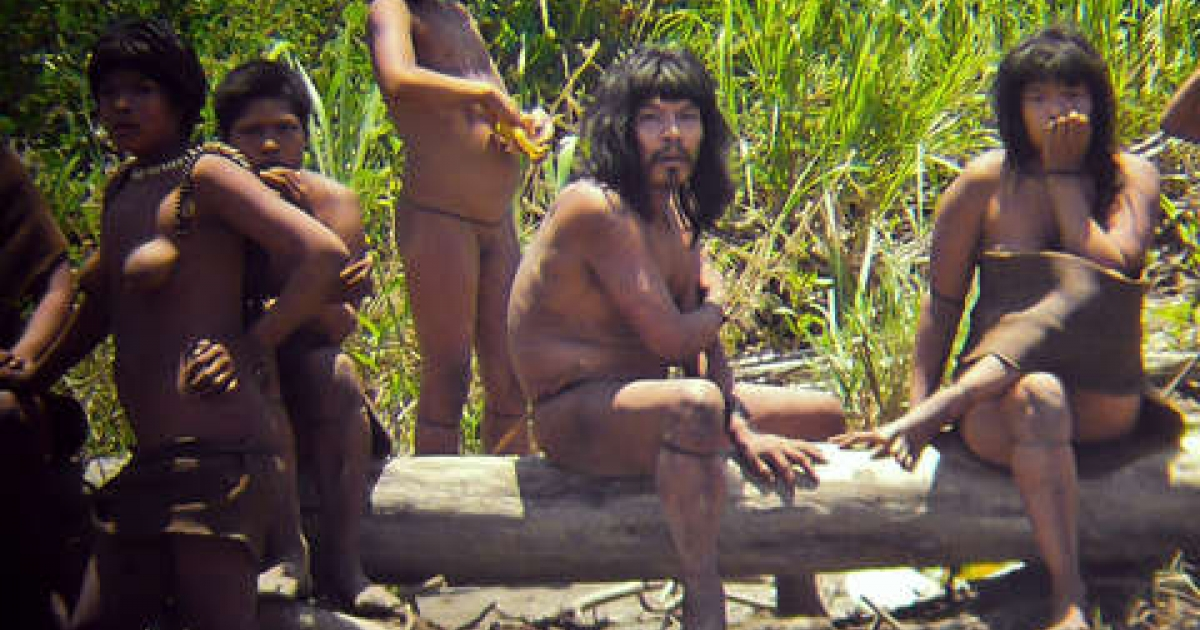 Diego Cortijo used a zoom lens to photograph these members of the Masco-Piro tribe in Peru. According to Survival International, this is the closest they have ever been seen. Photo courtesy D.Cortijo/uncontactedtribes.org</p>