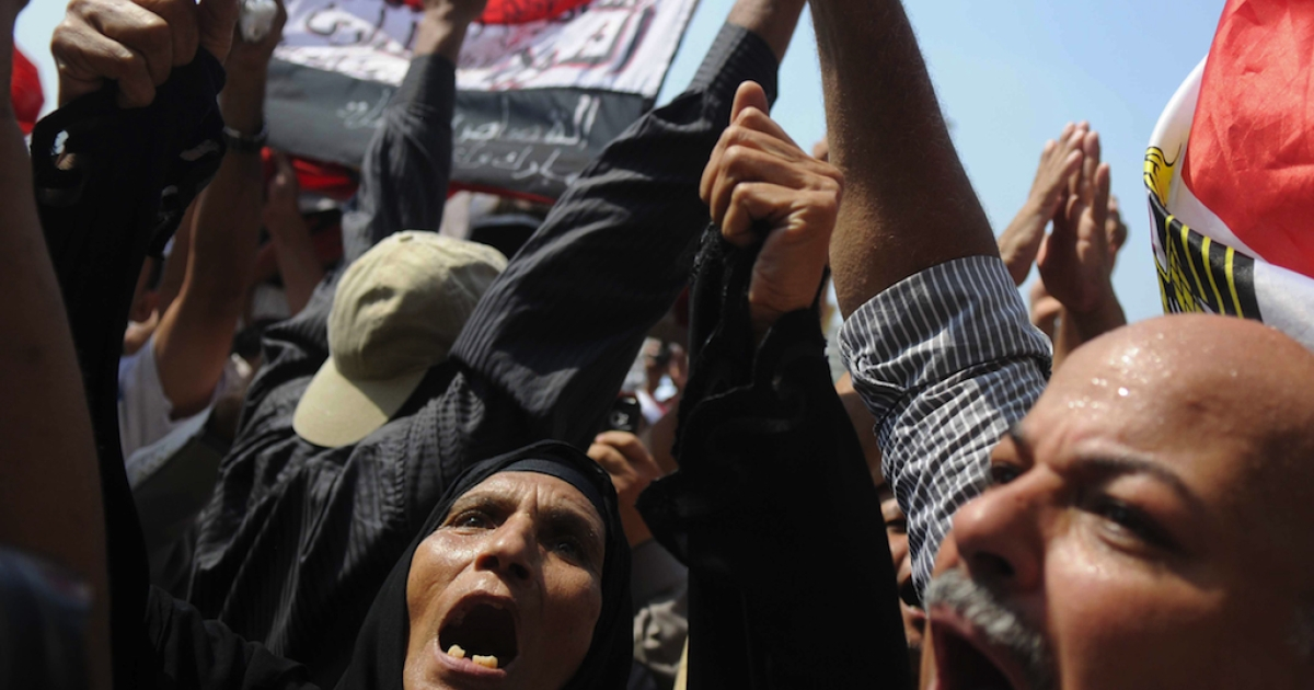 Egyptian protesters shout slogans as they gather in Cairo's Tahrir Square last September during a mass rally to reclaim the revolution amid anger over the military rulers' handling of the transition. YouTube sensation, Matt Harding, was met with anger from protestors when he turned up in Tahrir Square on Sunday.</p>