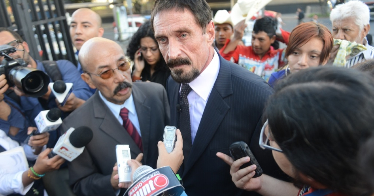 US anti-virus software pioneer John McAfee (R) answers questions to journalistas next to his Guatemalan lawyer Telesforo Guerra (L), in front of the Supreme Court in Guatemala City on December 04, 2012. McAfee, wanted for questioning over the murder of his neighbor last month in Belize, is seeking political asylum in Guatemala.</p>