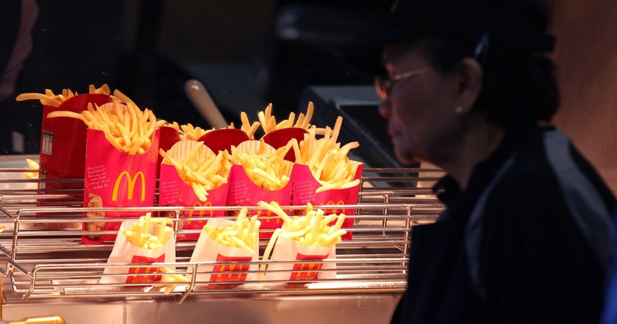 McDonald's french fries sit under a heat lamp at a McDonald's restaurant on April 19, 2011, in San Francisco, California.</p>