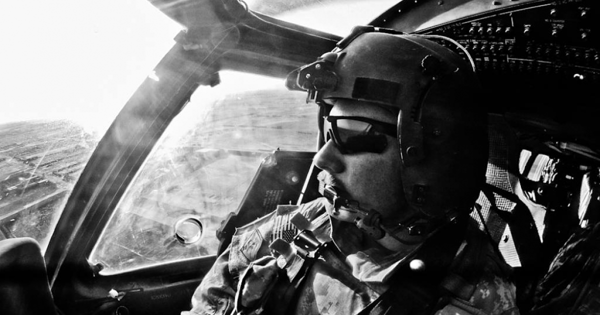 Chief Warrant Officer Matt Grove pilots a Black Hawk over Zhari's farmland on a Medevac mission.</p>