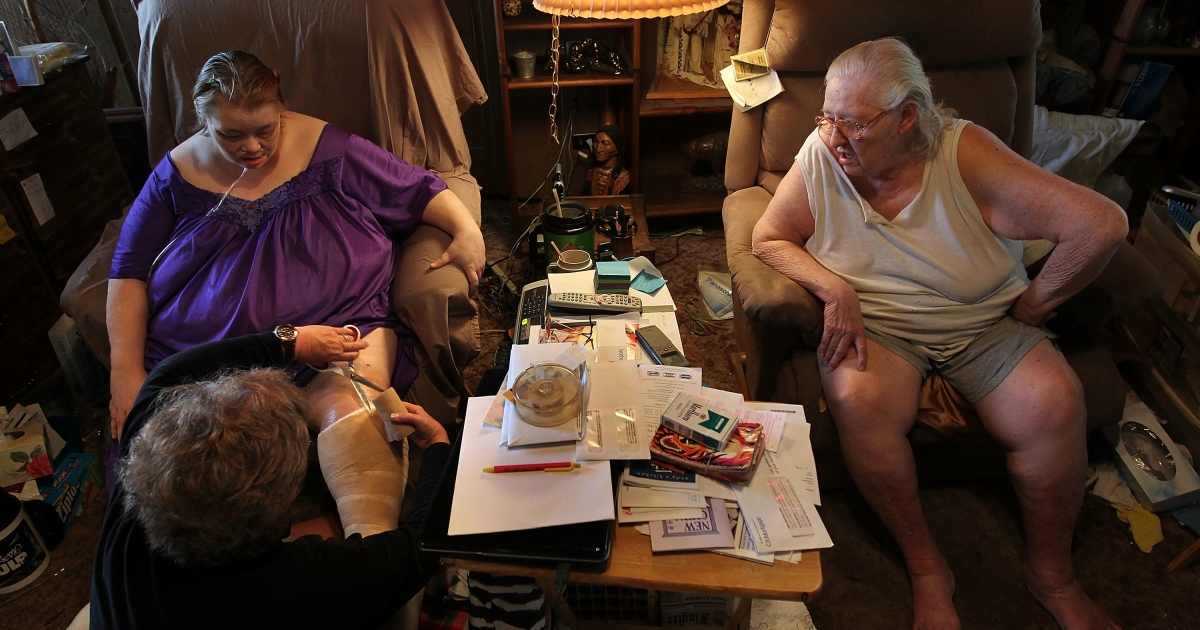 Registered nurse Susan Eager treats a patient suffering from obesity-related illnesses while performing a home health care visit in Denver, Colo., on Feb. 24, 2010.</p>