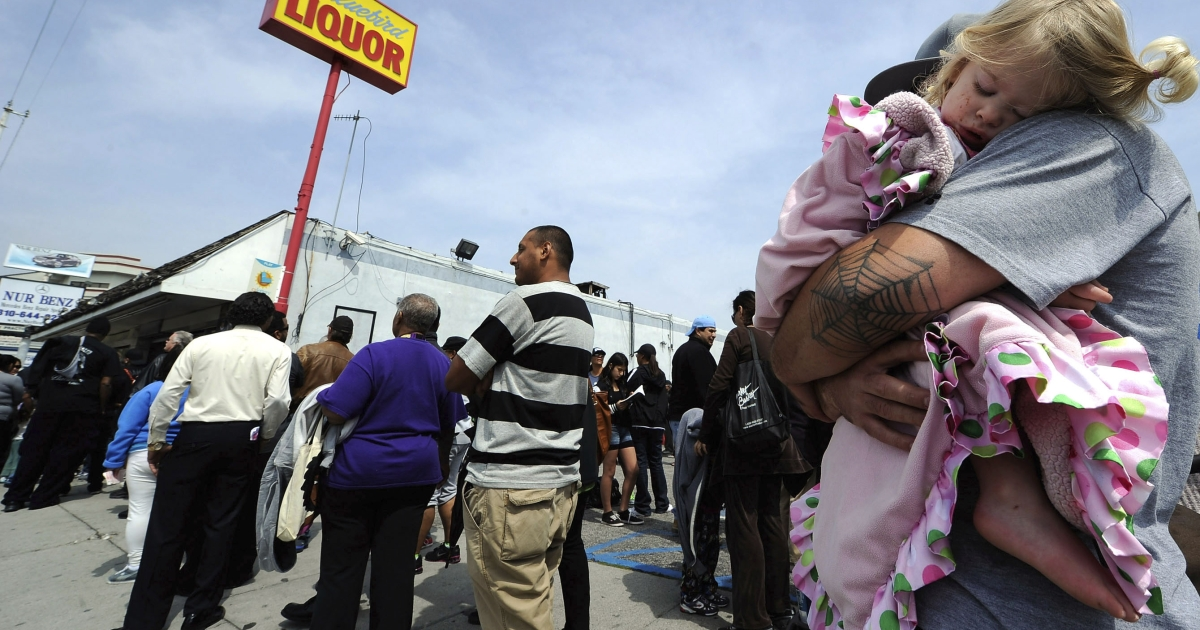 One year-old Karissa Sanchez sleeps on her ftaher Chris' shoulder as they wait three hours to buy their Mega Millions lottery tickets at Bluebird liquor store on March 29 in Hawthorne, Calif. The Mega Millions jackpot has reached a record high of $640 million.</p>