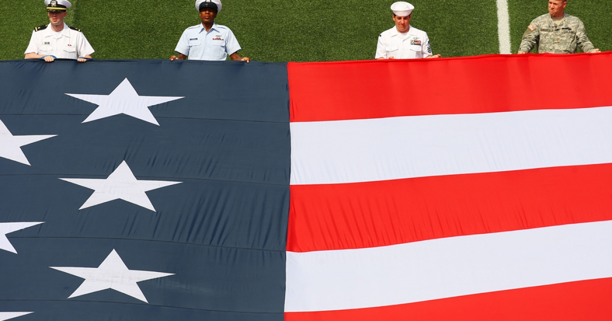 Members of the Armed Forces unveil the flag to celebrate Memorial Day prior to the game between the Chicago Fire and the New York Red Bulls at Giants Stadium in the Meadowlands on May 24, 2009 in East Rutherford, New Jersey.</p>