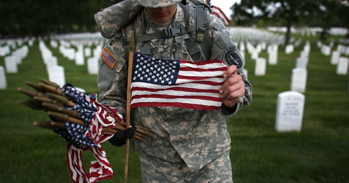 Pvt. John Hubbard of the 3rd U.S. Infantry Regiment places American flags at the graves of U.S. soldiers buried in Section 60 at Arlington National Cemetery in preparation for Memorial Day May 24, 2012 in Arlington, Virginia. 'Flags-In' has become an annual ceremony since the 3rd U.S. Infantry Regiment (The Old Guard) was designated to be an Army's official ceremonial unit in 1948.</p>
