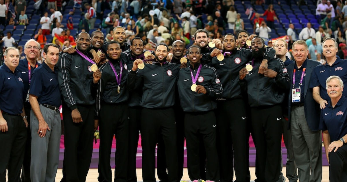 The USA men's team pose with their medals after the Men's Basketball gold medal game on Day 16 of the London 2012 Olympics Games at North Greenwich Arena on August 12, 2012 in London, England.</p>