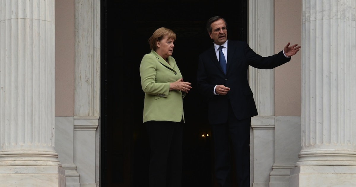 Greek Prime Minister Antonis Samaras welcomes German Chancellor Angela Merkel before their meeting in Athens on Oct. 9, 2012. It was Merkel's first visit to Greece since the debt crisis erupted almost three years ago; protestors geared up for a major show of discontent against painful austerity cuts.</p>