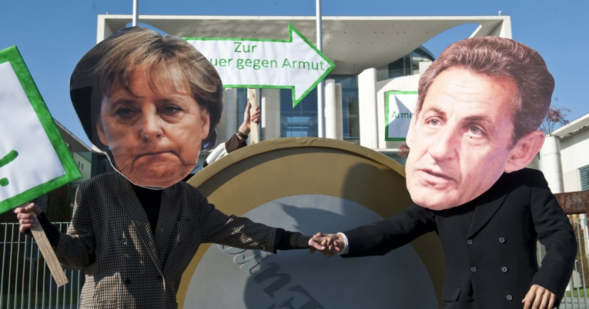 Protesters dressed as German Chancellor Angela Merkel and French President Nicolas Sarkozy stage a demonstration in front of the chancellery in Berlin October 21, 2011.</p>