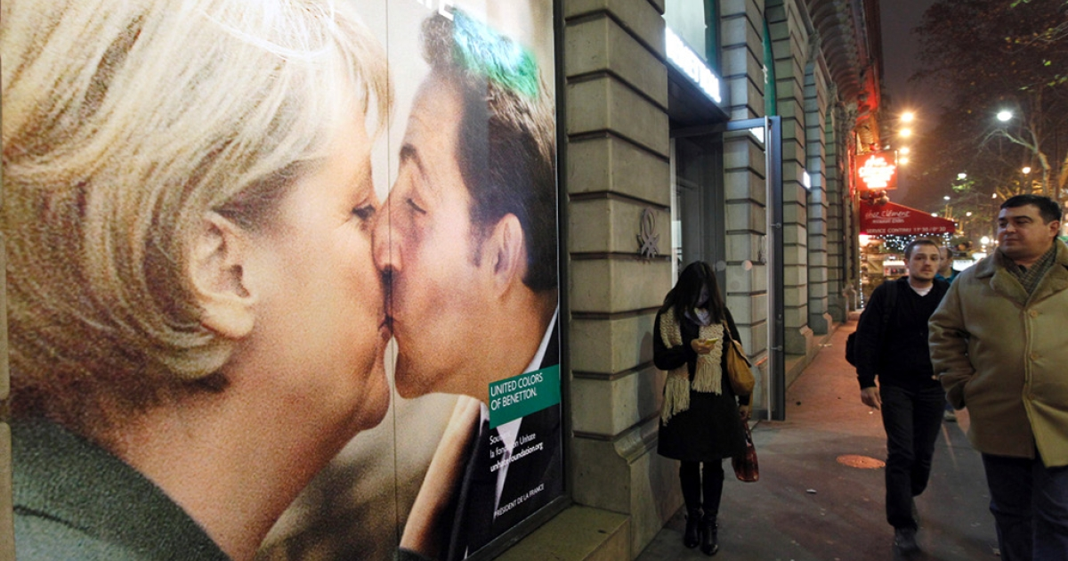 German Chancellor Angela Merkel and French President Nicolas Sarkozy are shown kissing in this advertisement.  What are the chances of a photo of Merkel kissing David Cameron ever making it into a Benetton ad?</p>