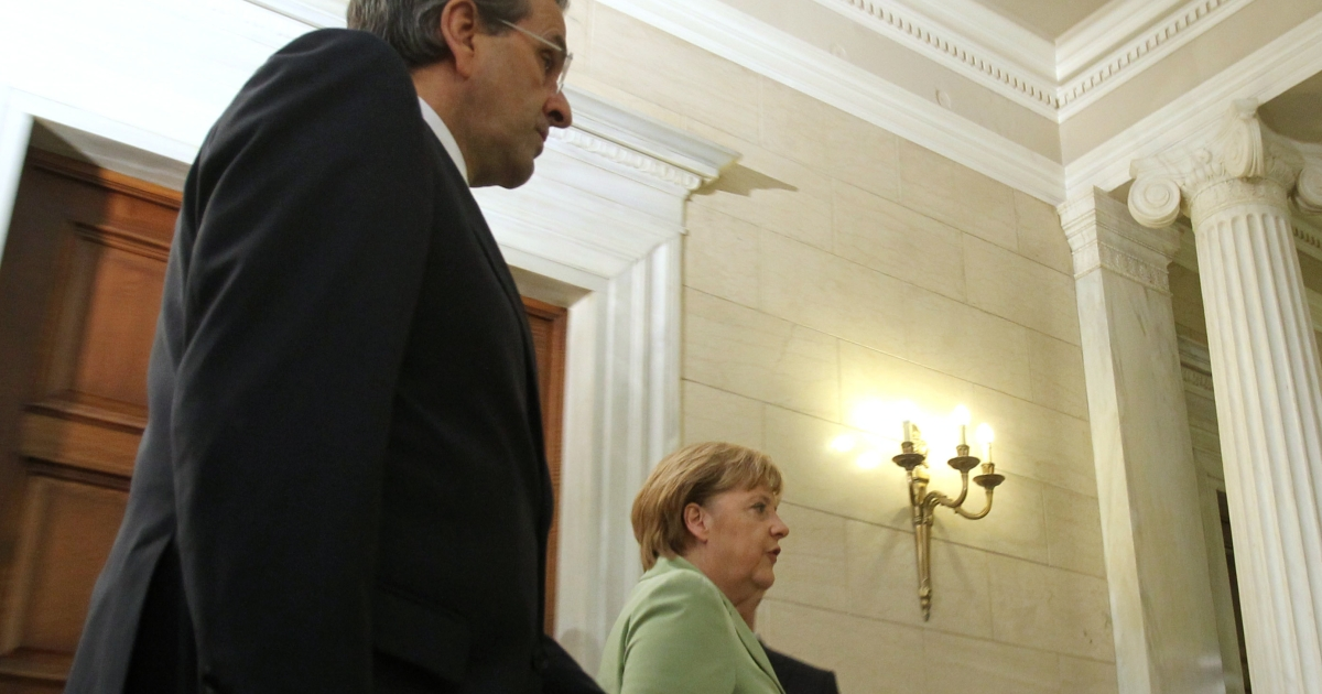 Angela Merkel with Greek Prime Minister Antonis Samaras in Athens on Tuesday.</p>