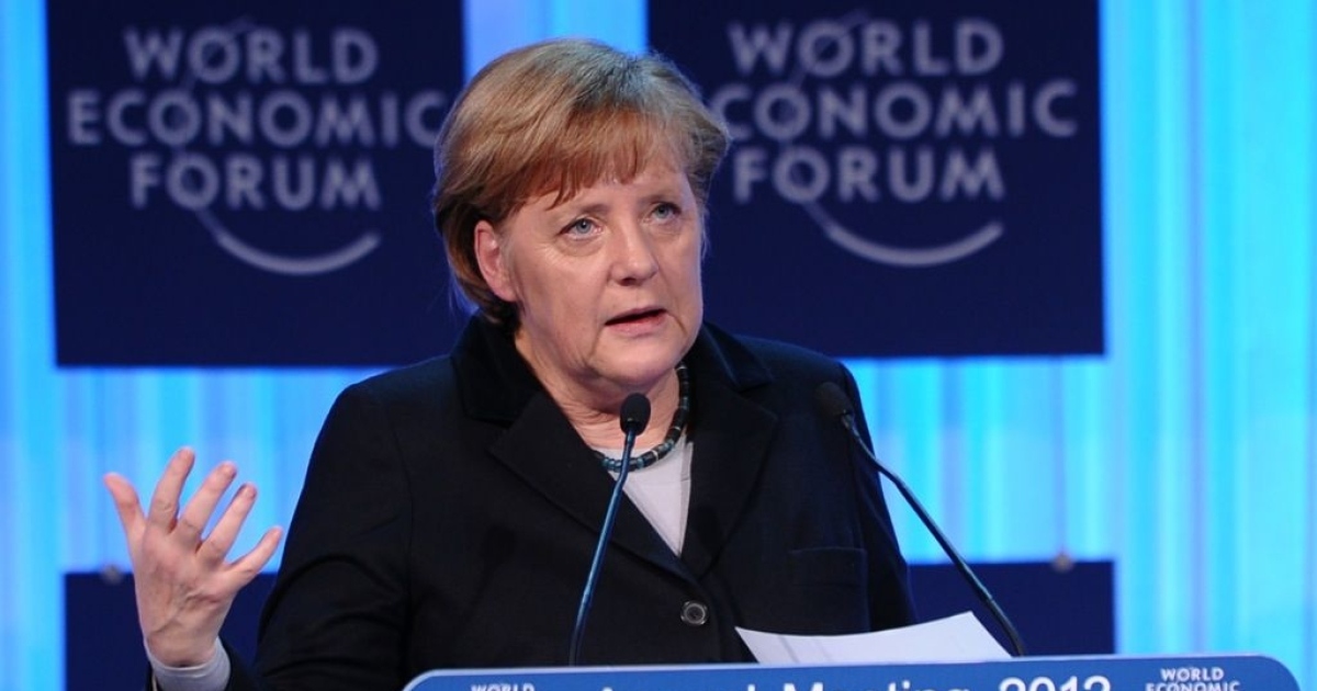 German Chancellor Angela Merkel delivers a speech during the opening ceremony of the World Economic Forum (WEF), in the congress center of the Swiss resort of Davos on January 25, 2012.</p>